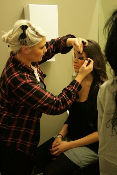 Designer Jay applying makeup to a model - Pagan Banfield