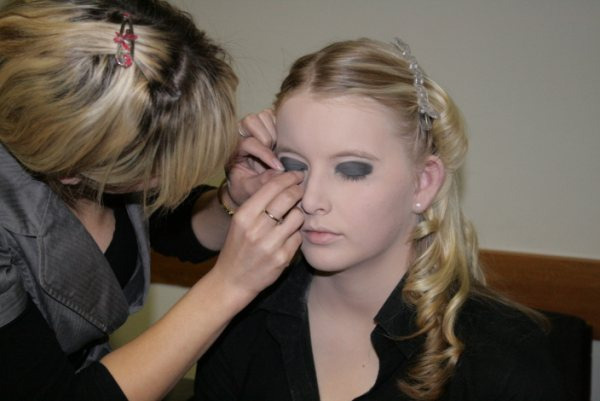 Jenna applying lashes to a model - Pagan Banfield